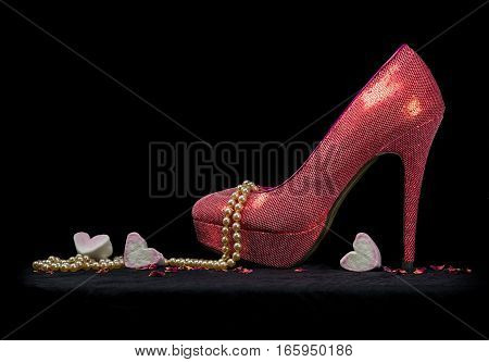 One Sexy Shoe, Pearls And Hearts, Black Background.