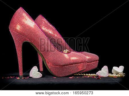 Pink High Heel Shoes On Black Background.