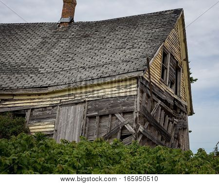 Sagging roof of an dilapidated house in prince edward island