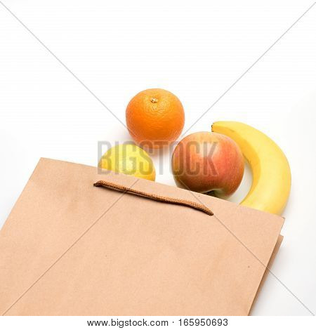 Banana, Lemon, Apple And Orange Fruit In Paper Package