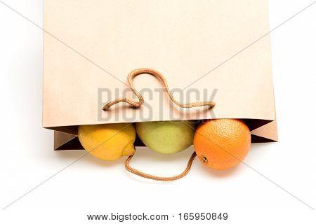 Lemon, Apple And Orange Fruit In Paper Package