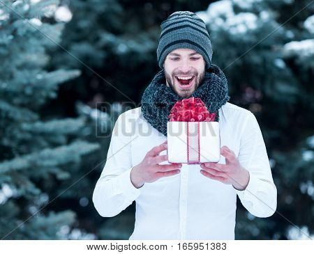 Handsome Man With Present Box In Winter Outdoor