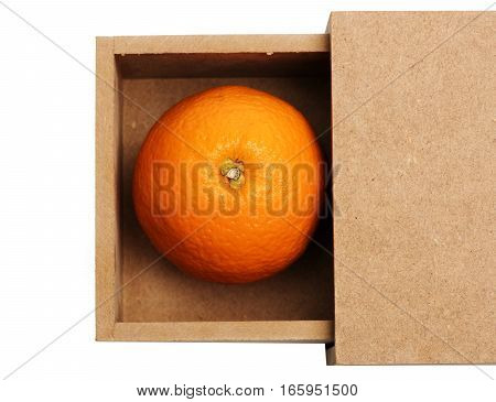 single orange citrus fruit with vitamin for healthy diet in wood or paper box isolated on white background copy space