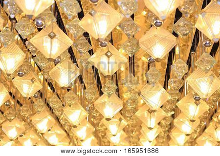 Shiny yellow  lanterns. Bright background with electric lights.