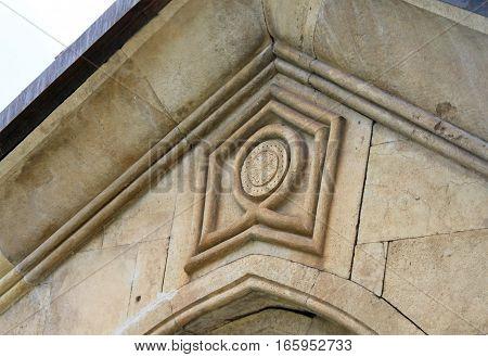 Sign on the wall of old orthodox monastery Gelati, near Kutaisi - Georgia