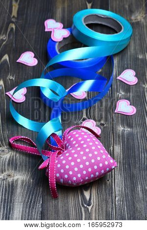 Felt Heart And Ribbon On Wood As Valentines Decoration