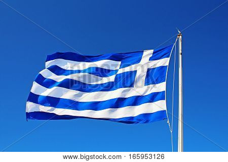 National flag of Greece over blue sky, Siuthern Europe