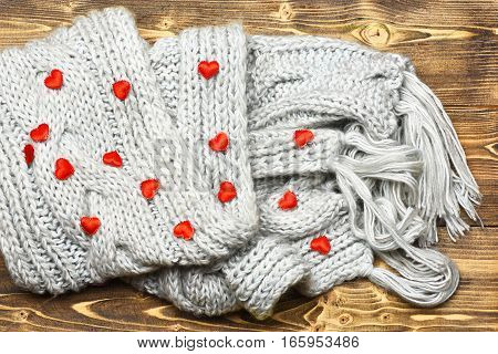 Red Valentines Heart And Grey Knitted Scarf On Wood
