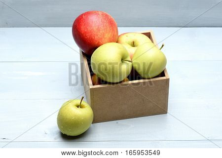 Red And Green Apple Fruit In Box Isolated On White
