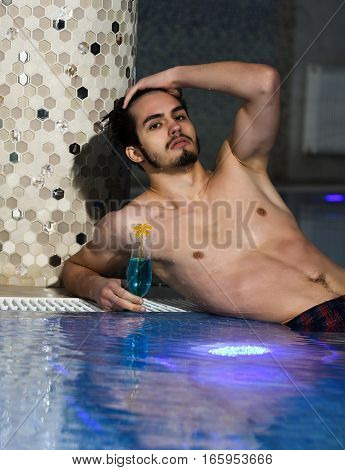 Handsome Man Lies Near Pool