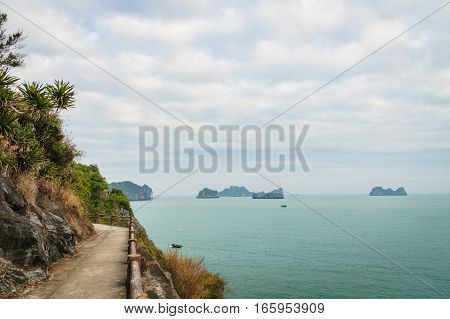 Hiking road by the ocean in Cat Ba, Ha long Bay, Vietnam, South East Asia.