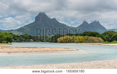 Rempart and Mamelles peaks from Tamarin Bay where the Indian Ocean meets the river Tamarin Black River District Mauritius.