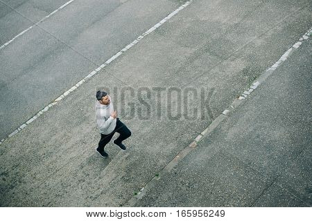 Sporty Man Running In Winter