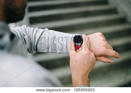Runner Using Sporty Smart Watch For Training