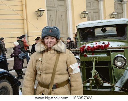 27.01.2014.Russia.Saint-Petersburg.Girl in winter uniform at the festival dedicated to the liberation of Leningrad.