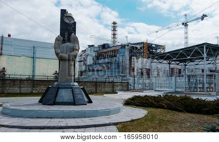 Chernobyl, Ukraine - April 24, 2015: Monument Of Dying People In The Tragedy Of Chernobyl, Backgroun