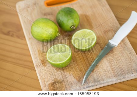 Sliced Tahiti Lemon over a woden board