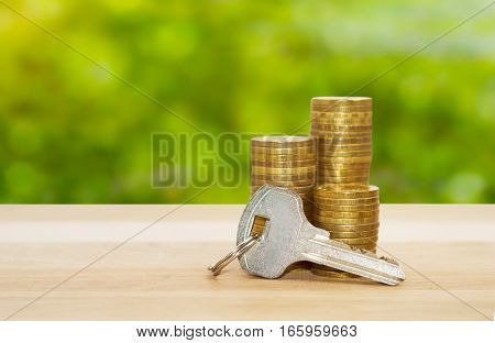 real-estate concept money coins stack with key