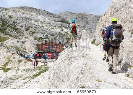 People At Alpine Hut Bullelejochhutte In Sexten Dolomites, South Tyrol, Italy