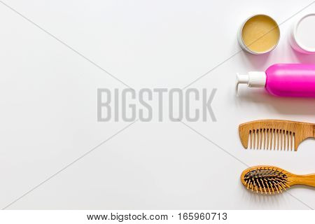 cosmetics for women haircare in bottle on white background top view