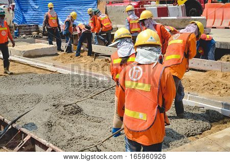 BANGKOK: May 31, 2016 Concrete pouring work during road concreting floors in construction on MAY 31, 2016  in Bangkok, Thailand.