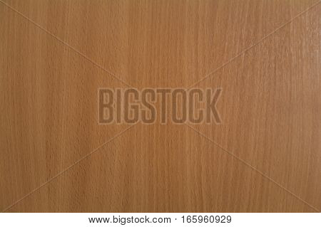 Textural background with light brown wood table.