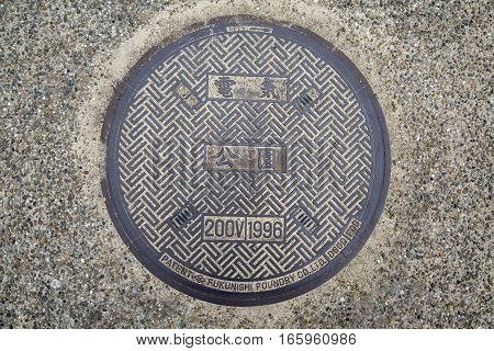 Circle Steel Manhole Cover Or Metal Sewer On The Street In Japan