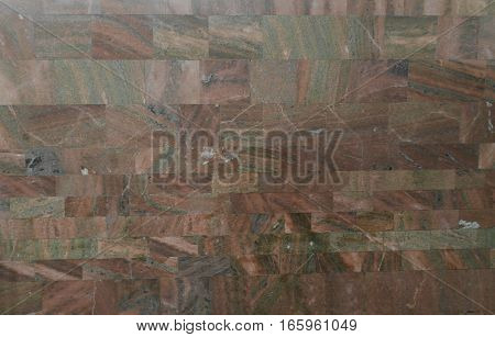 Textural background of brown stone wall tiles.