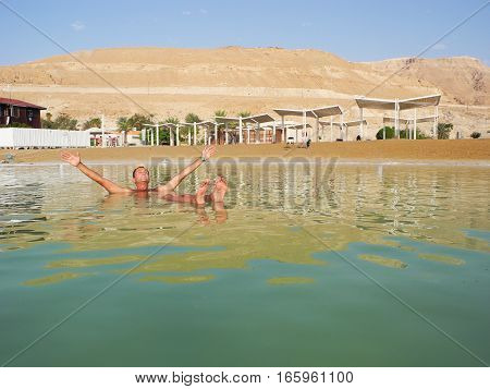 The man in the curative waters of the Dead Sea.
