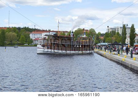 SAVONLINNA, FINLAND - JUNE 06, 2015: Retro ship departs from the waterfront on a tour of Saimaa lake. Savonlinna, Finland