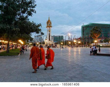 03 January 2017 samdach sothearos boulevard phnom penh cambodia monks walking over public square near wat botum park editorial