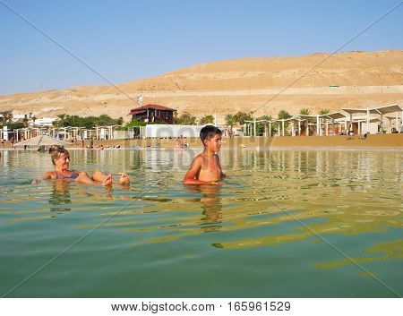 The people in the curative waters of the Dead Sea.