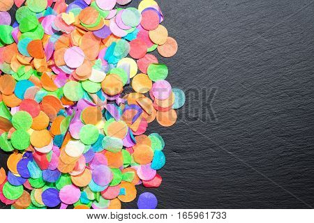 Colorful Confetti On Black Shale As Template For Celebration