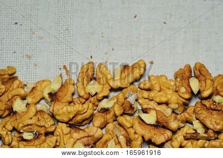 Top view of walnuts on natural kitchen linen background