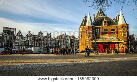 AMSTERDAM NETHERLANDS - JANUARY 05 2017: New Market square famous places of Amsterdam city centre at sun set time. General landscape view. January 05 2017 - Amsterdam - Netherlands.