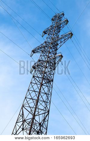 Transmission tower pilon against the blue sky