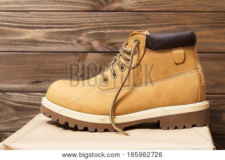 new leather boots on wooden background .