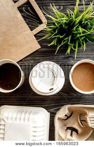 coffee break at dark wooden background top view