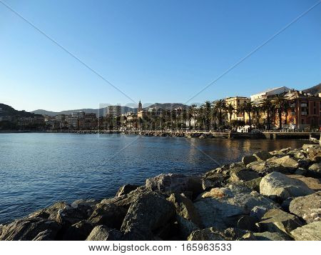 A shot of the coast of a small city in Italy in winter.