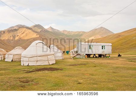 KYRGYZSTAN, CENTRAL ASIA - AUG 8, 2013: Traditional asian tents Yurts - homes of the local nomads in a Tian Shan mountains on August 8, 2013. Kyrgyzstan's population is 5.2 million. The country is rural