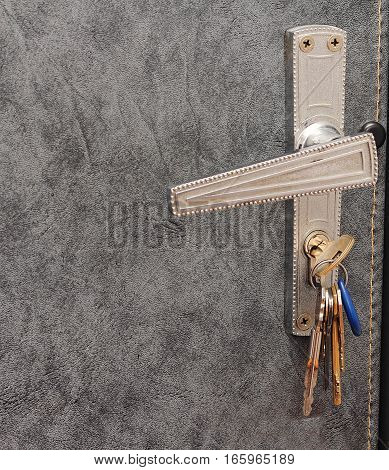 A bunch of keys in the keyhole of the door