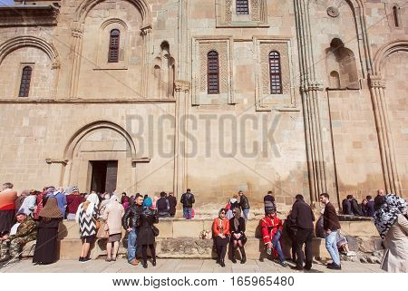 MTSKHETA, GEORGIA - OCT 14, 2016: Many people resting after religious ceremony in the famous orthodox Svetitskhoveli Cathedral, built in 4th century on October 14, 2016. UNESCO World Heritage Site.