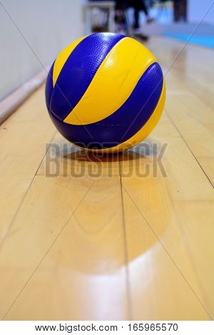 blue and yellow volleyball ball on the floor