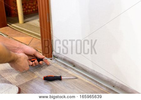 hand with screwdriver in the work repair
