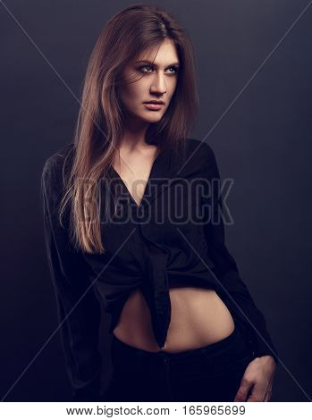 Grace Sexy Female Model Posing In Black Shirt With Long Hair Style On Dark Background. Toned Fashion