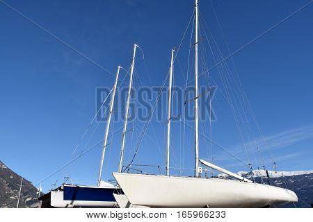 Boats ashore on the dock at the port of Bogliaco on Lake Garda - Brescia - Lombardy - Italy