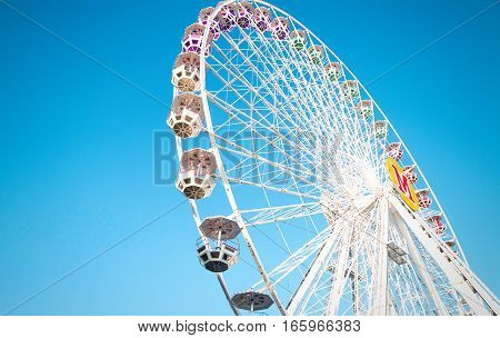 Ferris wheel on blue sky background card
