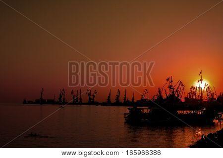 Sunset sky background landscape at indusrtial port of Ukraine
