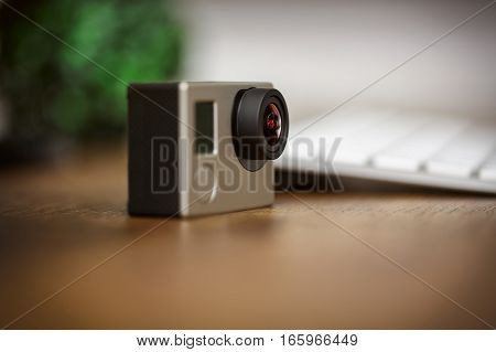 Gopro Camera Standing On The Desk