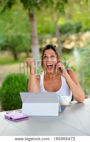 Successful Casual Woman With Laptop Outside